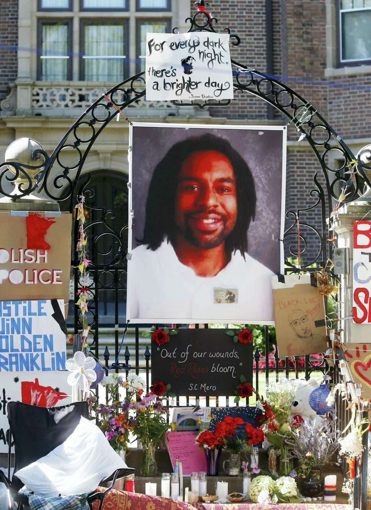 FILE - In this July 25, 2016, file photo, a memorial including a photo of Philando Castile adorns the gate to the governor's residence in St. Paul, Minn., protesting the July 6, 2016 shooting death of Castile by St. Anthony police officer Jeronimo Yanez. Closing arguments began Monday, June 12, 2017 in in a Yanez' manslaughter trial in the fatal shooting of Castile.