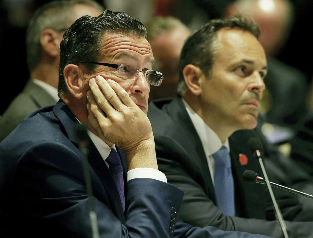 """Connecticut Democratic Gov. Dannel Malloy, left, and Kentucky Republican Gov. Matthew Bevin listens to a presentation during a session called """"Curbing The Opioid Epidemic"""" on the first day of the National Governor's Association meeting Thursday, July 13, 2017, in Providence, R.I."""