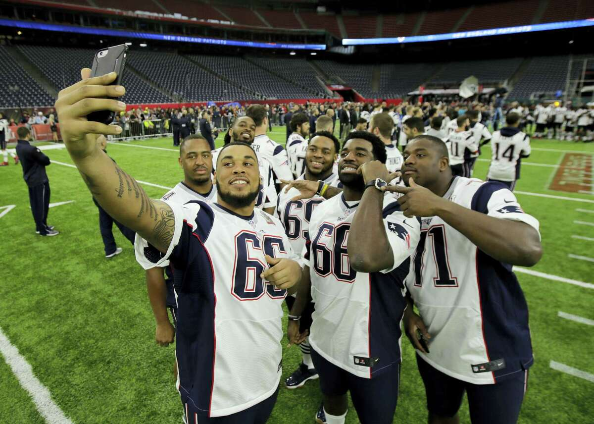 Patriots players take a selfie during a walk through at NRG Stadium on Saturday.