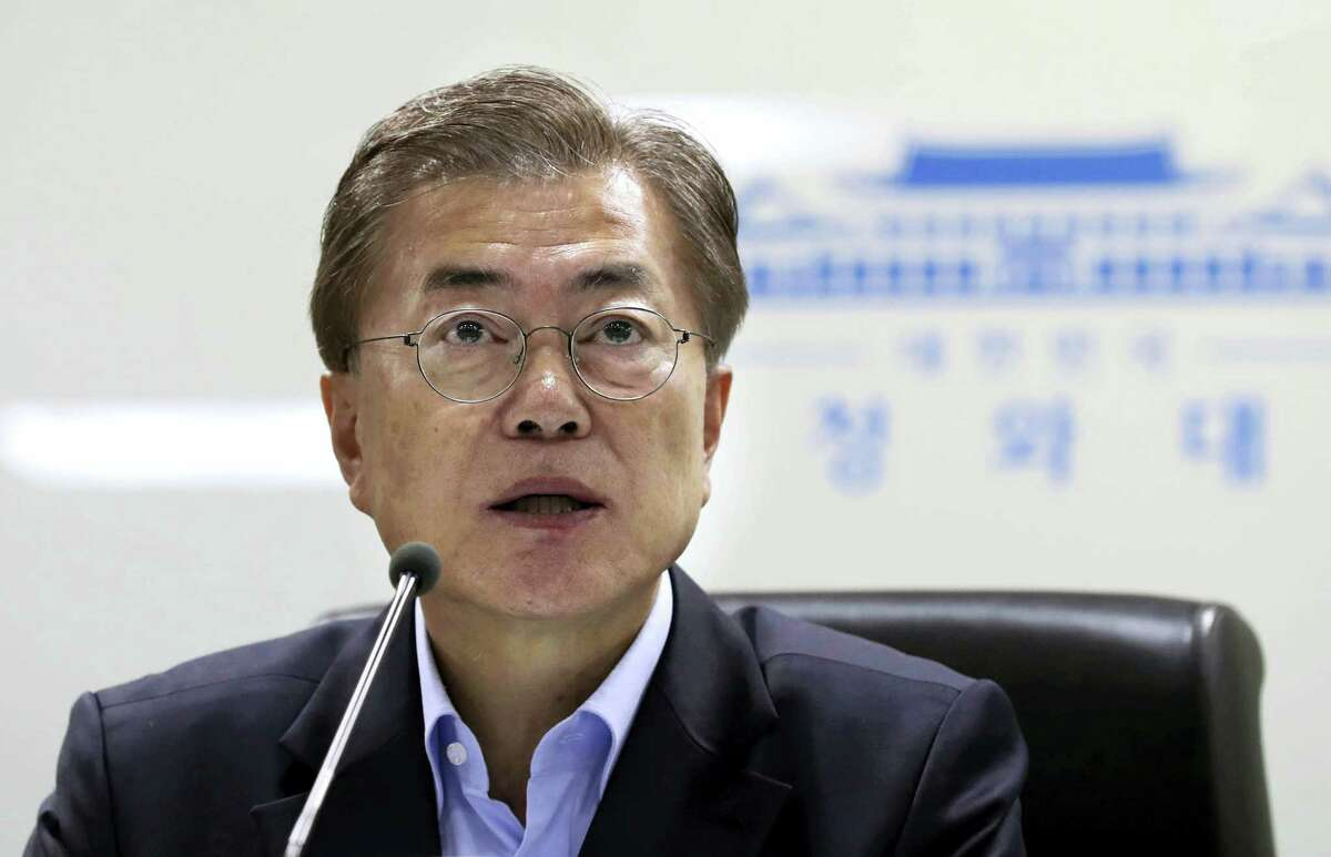 South Korean President Moon Jae-in speaks as he presides over a meeting of the National Security Council at the presidential Blue House in Seoul, South Korea, May 14, 2017. North Korea on Sunday test-launched a ballistic missile that landed in the Sea of Japan, the South Korean, Japanese and U.S. militaries said. The launch is a direct challenge to the new South Korean president elected four days ago and comes as U.S., Japanese and European navies gather for joint war games in the Pacific. (Yonhap via AP)
