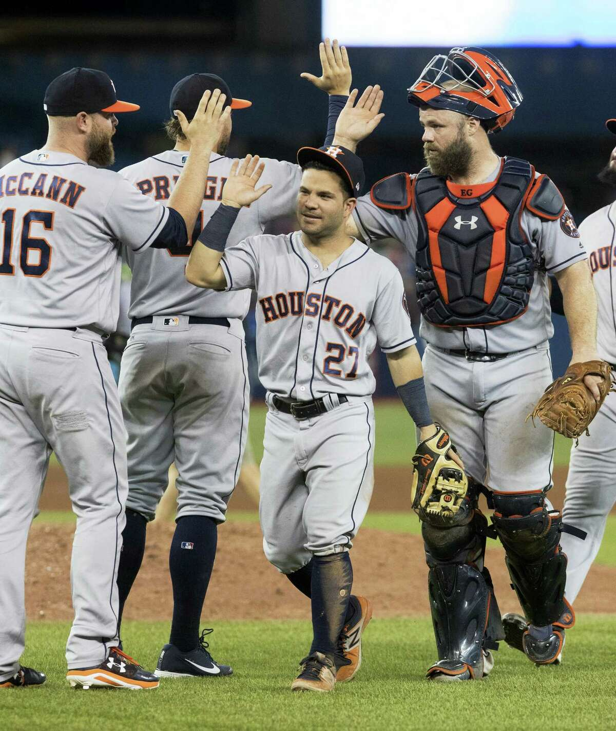 The Houston Astros celebrate after defeating the Toronto Blue Jays 12-2 in a baseball game Friday in Toronto.