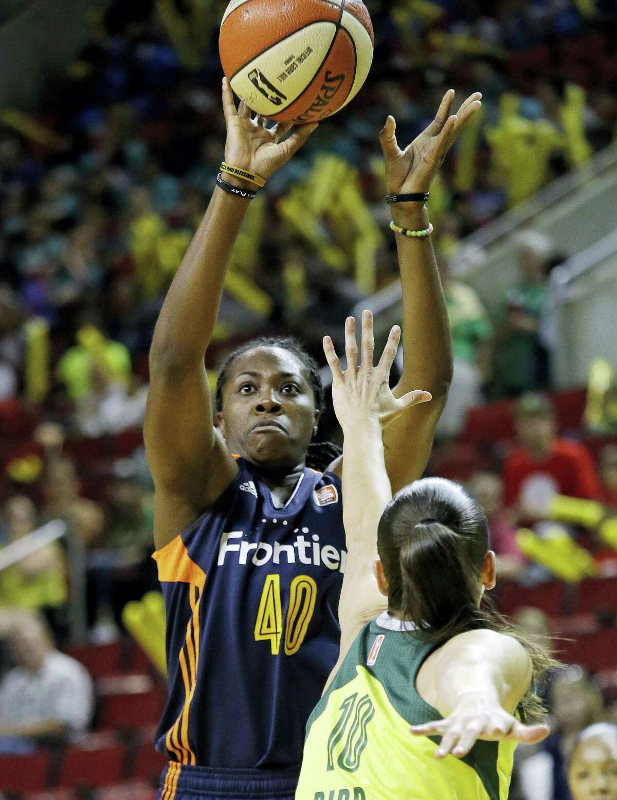 The Sun's Shekinna Stricklen shoots over the Storm's Sue Bird in the first half on Wednesday.
