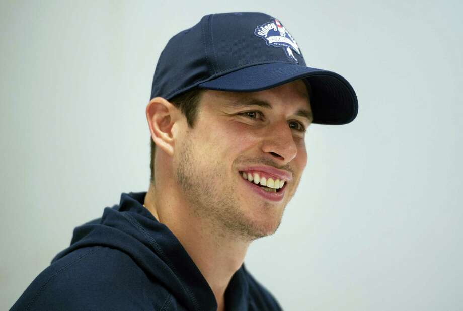 The Penguins' Sidney Crosby laughs while speaking to reporters during a press conference in Halifax, Nova Scotia, on Wednesday. Photo: Darren Calabrese — The Canadian Press Via AP  / The Canadian Press