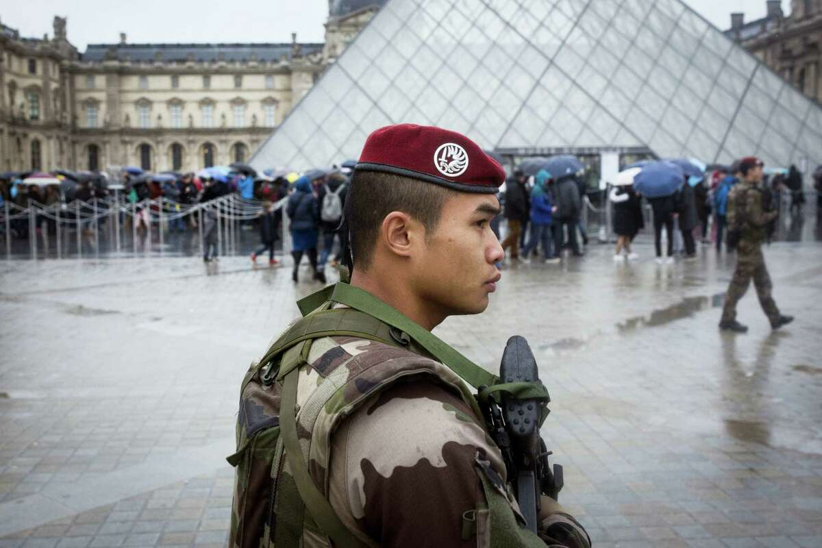 """AP Photo/Kamil Zihnioglu A French soldier patrols in the courtyard of the Louvre museum in Paris, Saturday, Feb. 4, 2017. The Louvre in Paris reopened to the public Saturday morning, less than 24-hours after a machete-wielding assailant shouting """"Allahu Akbar!"""" was shot by soldiers, in what officials described as a suspected terror attack."""