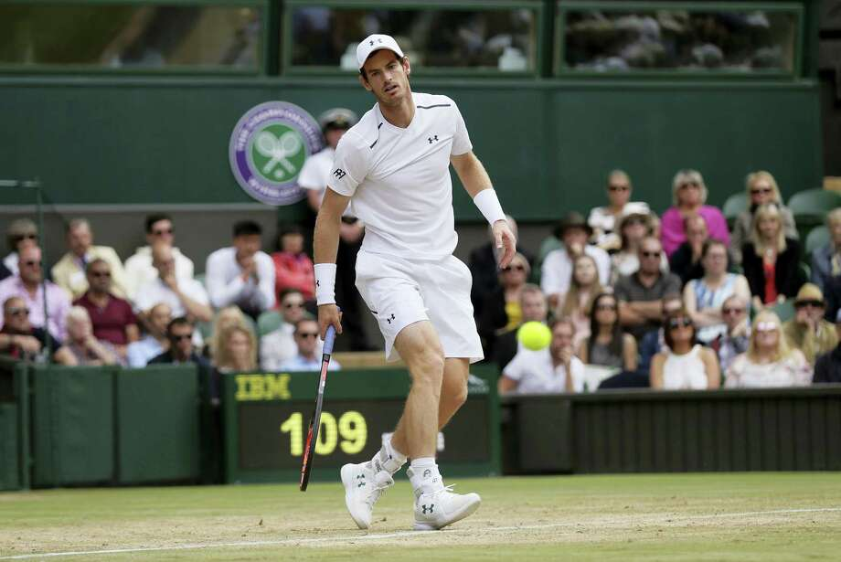Andy Murray watches as a shot from Sam Querrey passes by him during their men's singles quarterfinal match at Wimbledon on Wednesday. Photo: Tim Ireland — The Associated Press  / Copyright 2017 The Associated Press. All rights reserved.