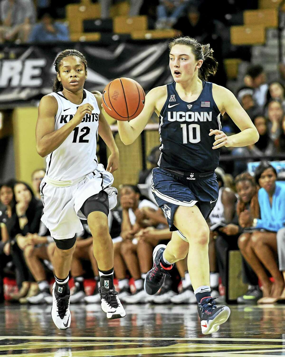 Connecticut guard Molly Bent (10) dribbles away from Central Florida forward Nyala Shuler (12) as she leads the break during the second half of an NCAA college basketball game, Sunday, Jan. 1, 2017, in Orlando, Fla. Connecticut defeated UCF 84-48. (AP Photo/Roy K. Miller)