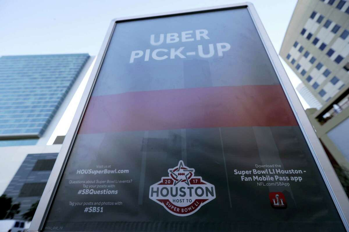 A sign marks an Uber designated pick-up point near the NFL Experience in downtown Houston.