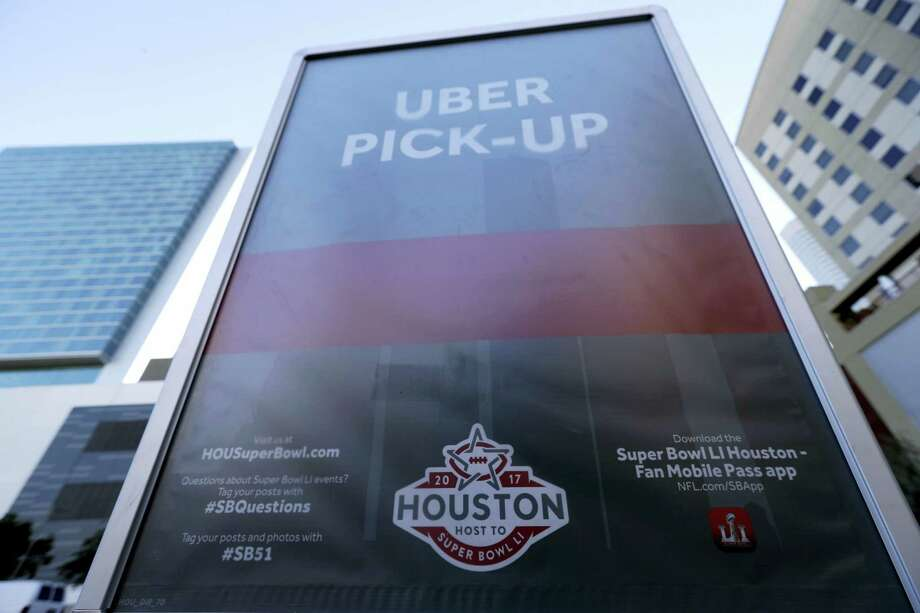 A sign marks an Uber designated pick-up point near the NFL Experience in downtown Houston. Photo: David J. Phillip — AP Photo  / Copyright 2017 The Associated Press. All rights reserved.
