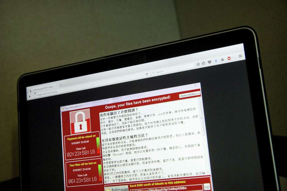 A screenshot of the warning screen from a purported ransomware attack, as captured by a computer user in Taiwan, is seen on laptop in Beijing on May 13, 2017. Dozens of countries were hit with a huge cyberextortion attack Friday that locked up computers and held users' files for ransom at a multitude of hospitals, companies and government agencies. Photo: AP Photo — Mark Schiefelbein  / Copyright 2017 The Associated Press. All rights reserved.
