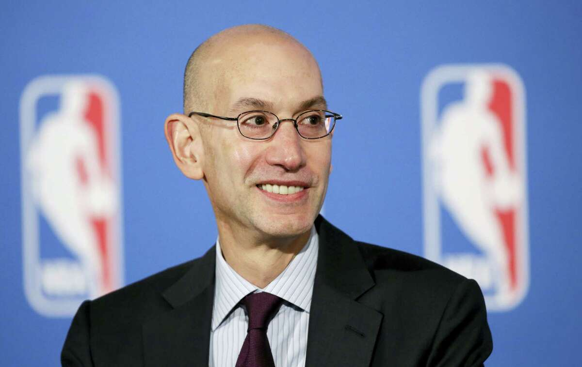 NBA Commissioner Adam Silver answers questions at a news conference after a deal was announced between the league and TV networks on Oct. 6, 2014 in New York.