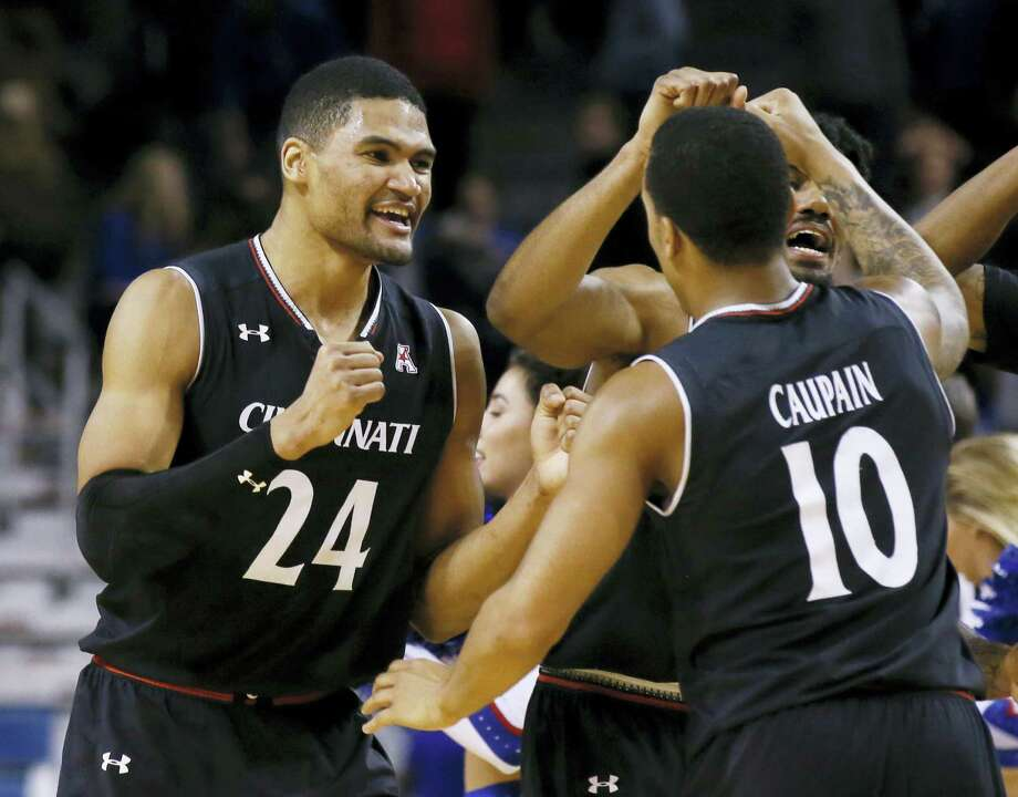 Cincinnati forward Kyle Washington (24) celebrates with Troy Caupain (10) after Wednesday's win over Tulsa. Photo: Sue Ogrocki — The Associated Press  / AP2017