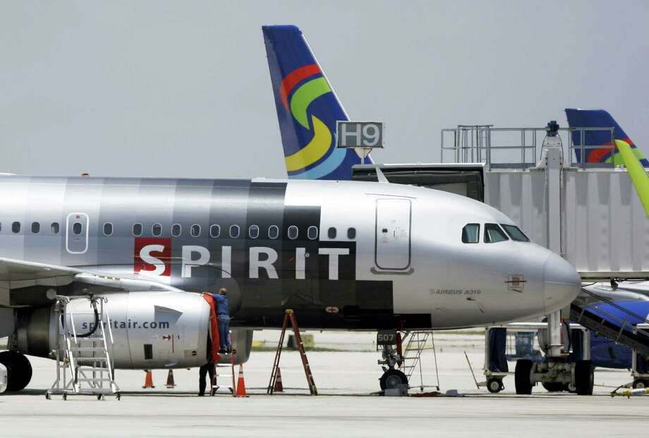 A Spirit Airlines airplane sits on the tarmac at Fort Lauderdale-Hollywood International Airport. A Texas State student was trying to fly to Fort Lauderdale from Baltimore/Washington International when she was barred from boarding her Spirit plane because she was carrying on a pet hamster. Photo: The Associated Press  / AP