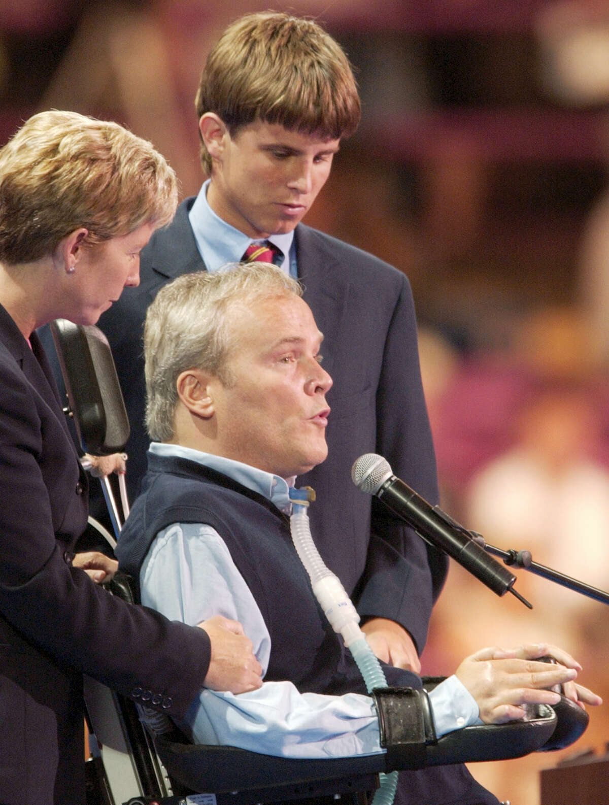 Disabled former New York City police officer Steven McDonald addresses delegates, as family members stand beside him at Madison Square Garden during the Republican National Convention in New York in 2004. McDonald, who was paralyzed by a bullet and became an international voice for peace after he publicly forgave the gunman, died Tuesday, Jan. 10, 2017, at the age of 59.