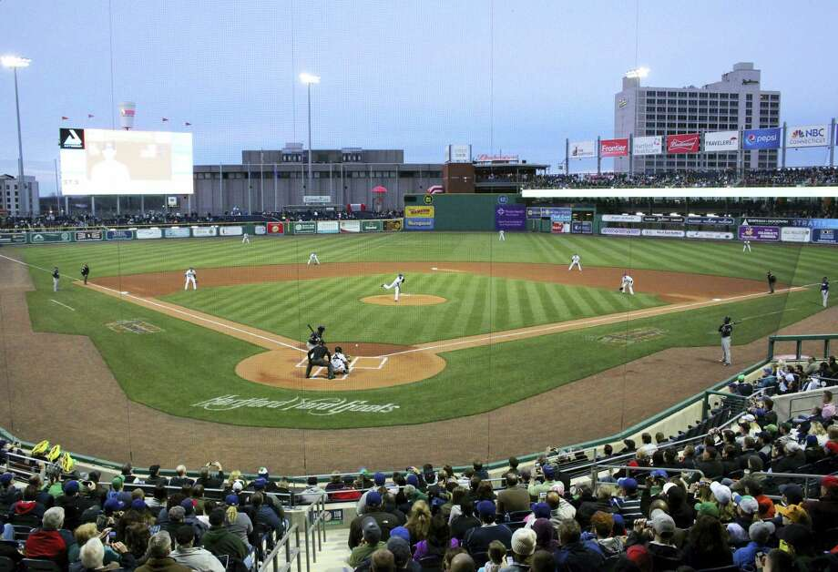 Hartford Yard Goats pitcher Yency Almonte throws the first official pitch at Hartford's new Dunkin' Donuts Park on opening day in Hartford, Conn., Thursday, April 13, 2017. The city and its minor league baseball team are celebrating opening day at the city's new 6,000-seat stadium, a year late and millions of dollars over budget. (AP Photo/Pat Eaton-Robb) Photo: AP / Copyright 2017 The Associated Press. All rights reserved.