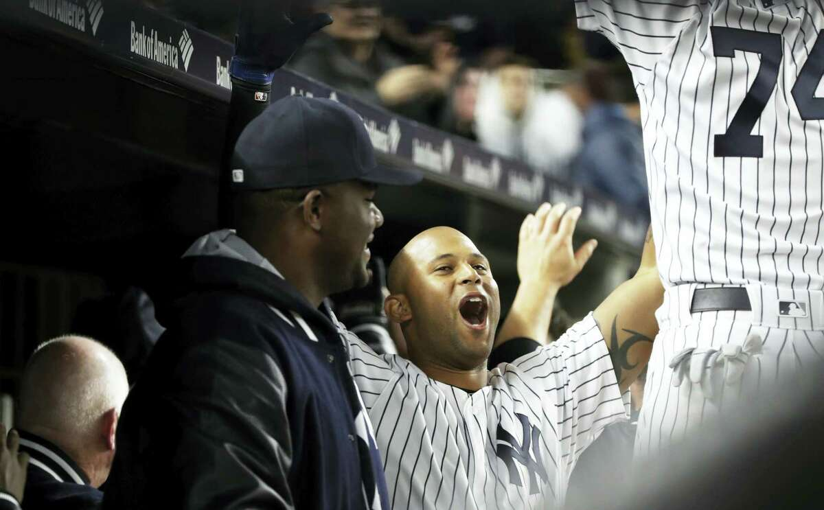 The Yankees' Aaron Hicks celebrates with teammates after hitting a two-run home run during the seventh inning against the Rays on Thursday.