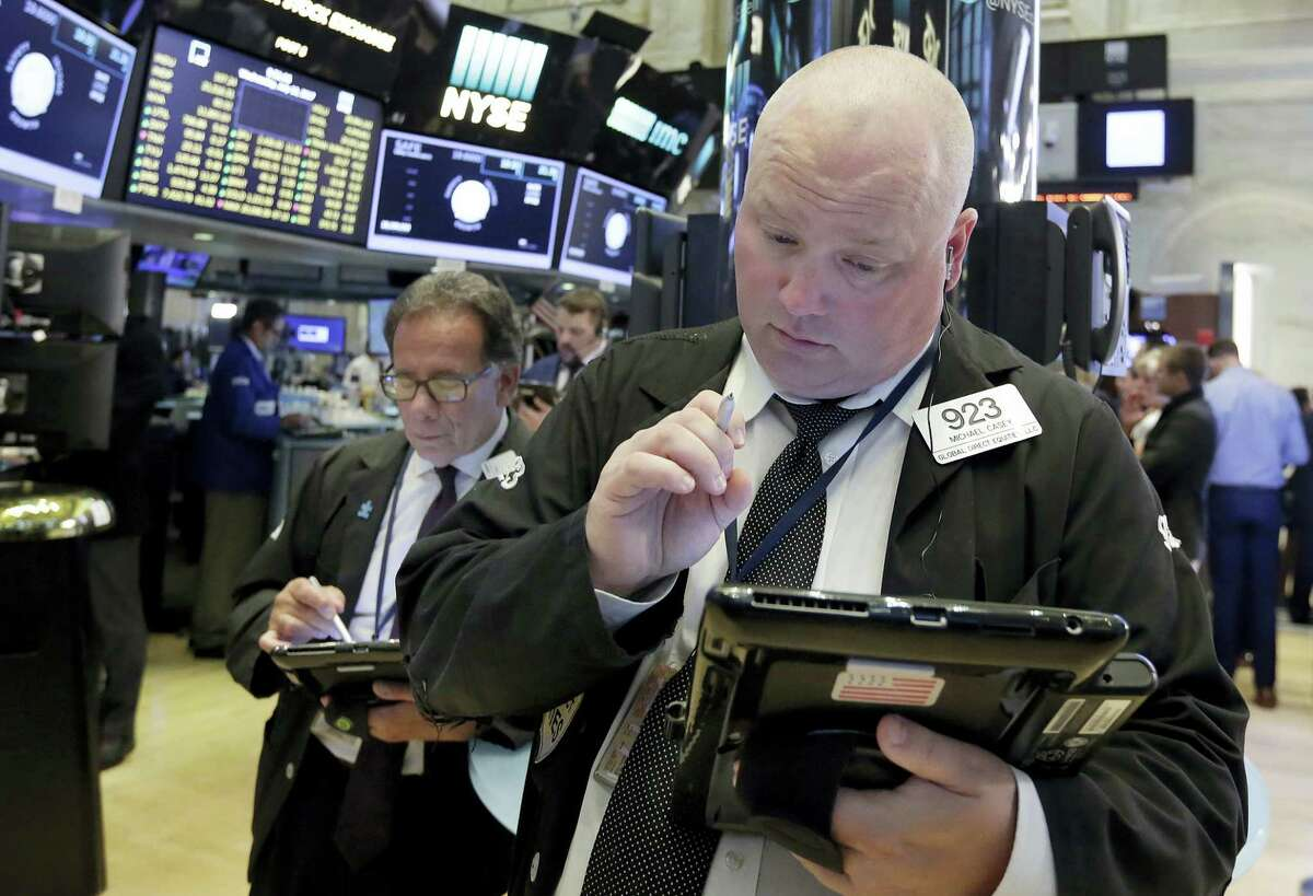 Traders Michael Casey, right, and Sal Suarino work on the floor of the New York Stock Exchange Wednesday.