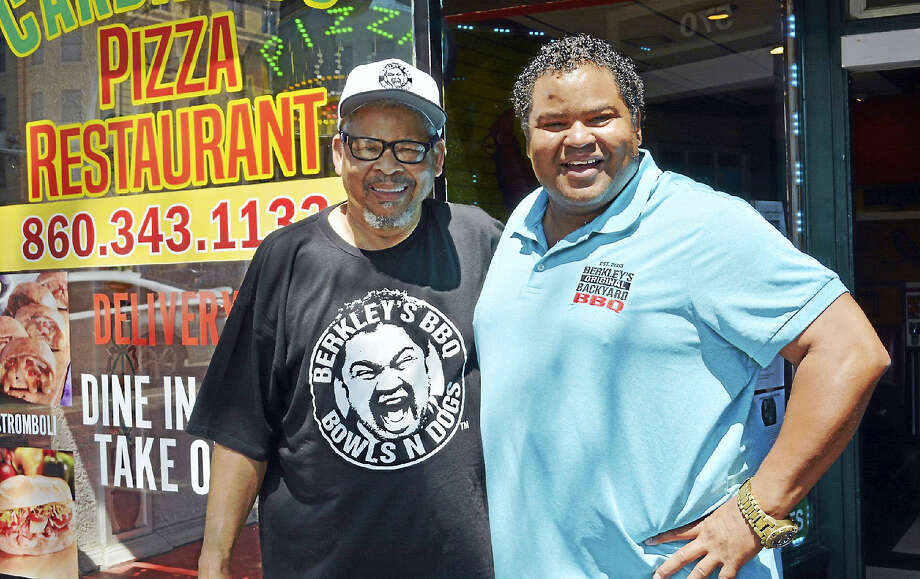 Raymond Hoagland, left, and son Berkley Hoagland, formerly of Middletown and East Hampton, stand out front of Cardinal's Pizza on Main Street in Middletown, the location of the former Hoagie's BBQ and Pizza, the second incarnation of their popular North End ribs restaurant. Hoagies BBQ, which burned in a fire in the early 80s, began next door to where Keagan's Irish Bar stands now. The eatery later moved to Cromwell Square Shopping Center on Shunpike Road for a time. Photo: Cassandra Day — The Middletown Press