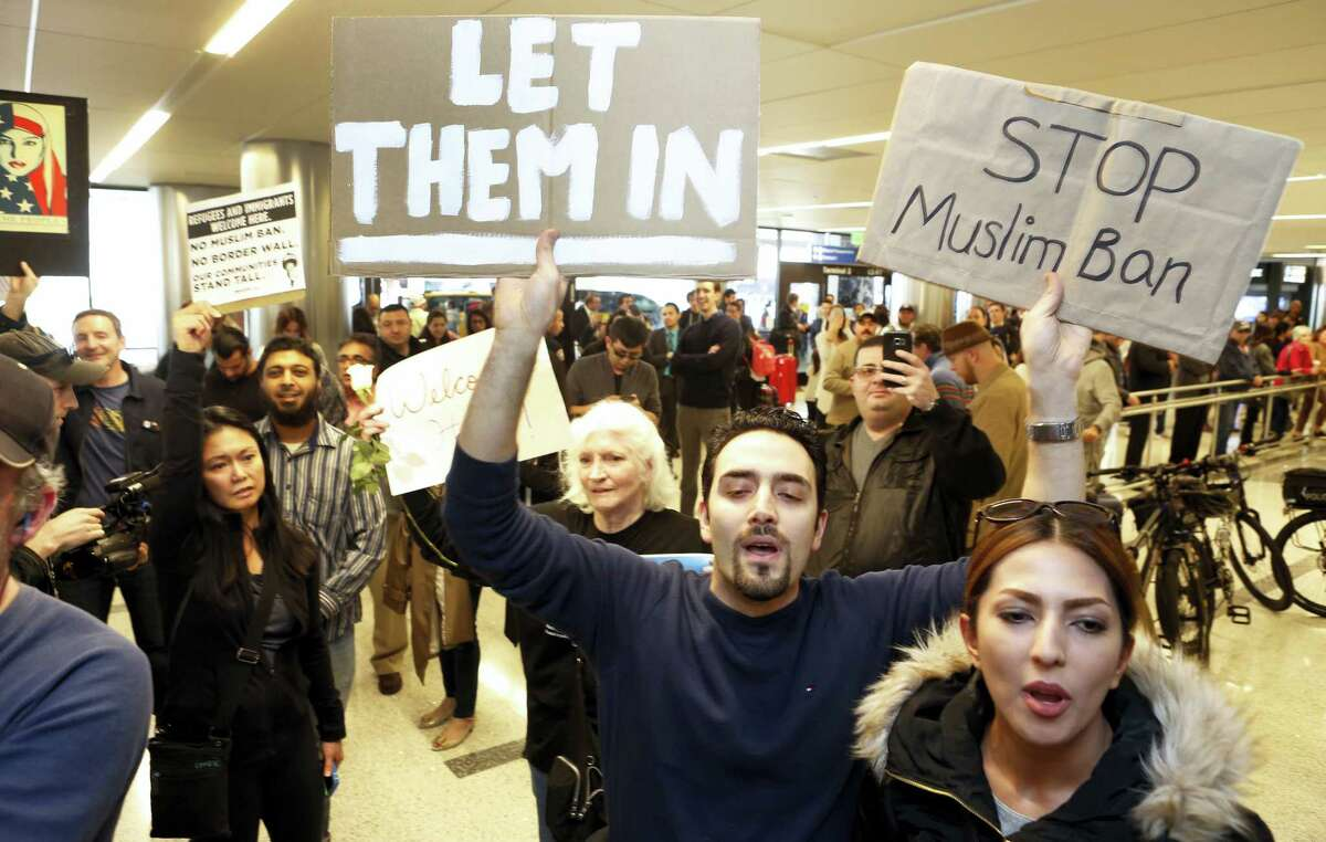 Supporters cheer as an Iranian citizen with a valid U.S. visa arrives at Los Angeles International Airport Thursday, Feb. 2, 2017.