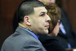 In this April 11, 2017 photo, defendant Aaron Hernandez listens as Judge Jeffrey Locke addresses the jury's question during his double murder trial at Suffolk Superior Court in Boston. A wrongful death lawsuit filed against the estate of former NFL star Aaron Hernandez is headed back to court. A status hearing is scheduled for Tuesday, July 11, 2017 in Suffolk County Superior Court.