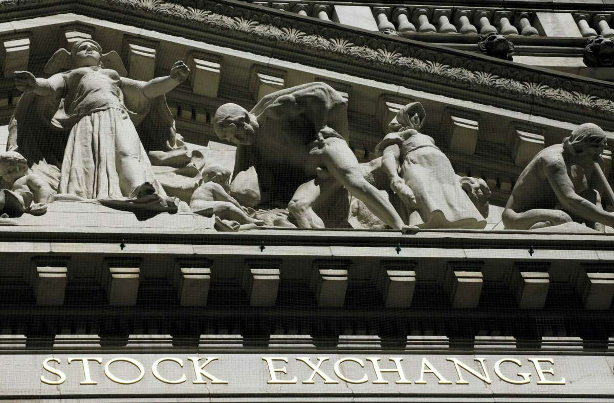 """FILE - This July 15, 2013, file photo, shows the New York Stock Exchange. Global stock markets turned lower and the dollar was volatile Thursday, April 13, 2017, after President Donald Trump withdrew a threat to declare China a currency manipulator and said the U.S. currency was """"getting too strong."""" Tensions over North Korea also weighed on investors ahead of a long weekend in many markets."""