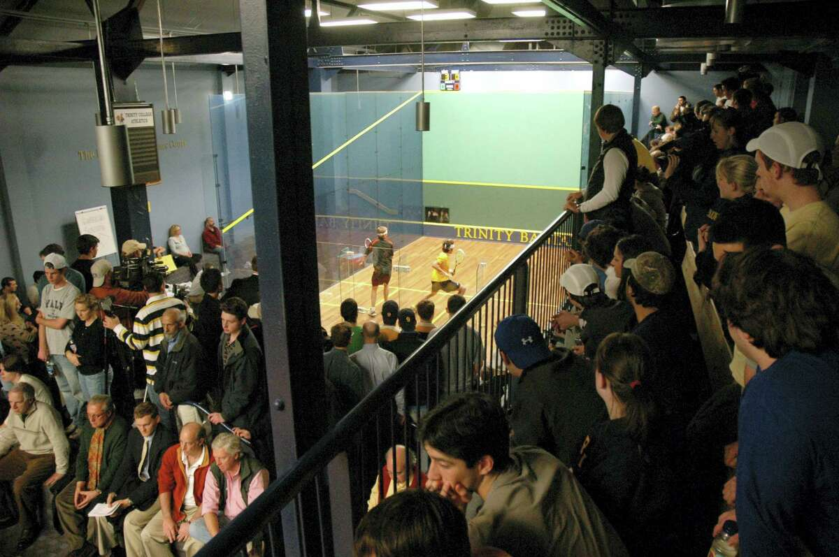 Spectators crammed the lofts to watch Princeton University's David Letourneau in a match against Trinity College's Manek Mathur, Jr. (yellow jersey) at the George A. Kellner Squash Center on the campus of Trinity College in Hartford in 2008. UConn's women's basketball team is on the verge of winning its 91st straight game, which would break its own NCAA Division I record that was set between 2008 and 2010. The streak ranks among the most impressive in sports but UConn's women don't own the longest winning streak in college sports history, or even in the state of Connecticut. That streak belongs to the Trinity University men's squash team.
