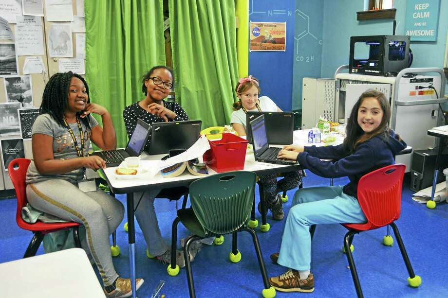 From left, Macdonough fifth-graders Zaharoa Sumani, Nya Chambers, Lily Collins and Sadie Cohen enjoy lunch in Ferrero's classroom Friday afternoon. Photo: Cassandra Day — The Middletown Press