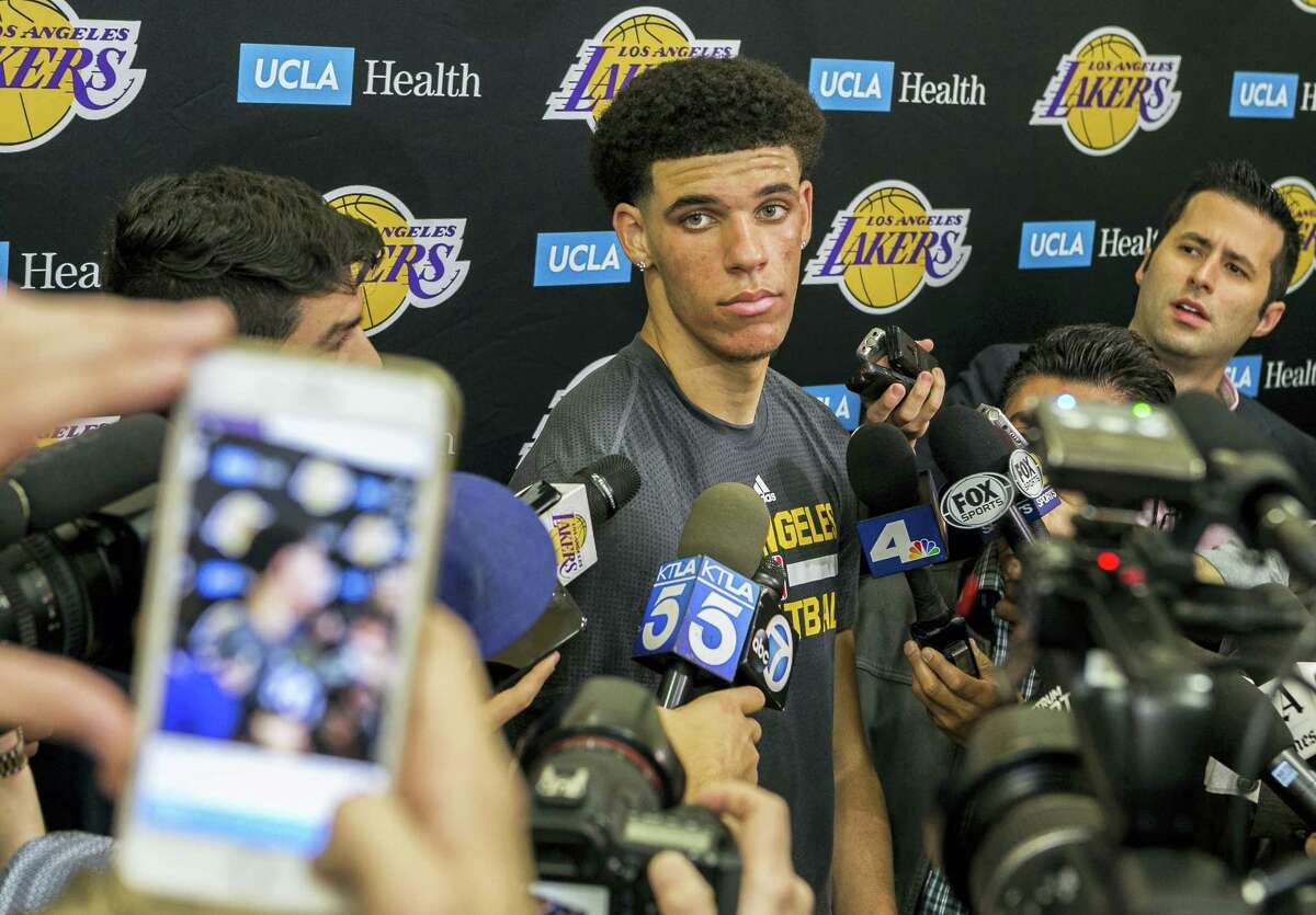 University of California Los Angeles guard Lonzo Ball takes questions from the media after a closed Los Angeles Lakes pre-draft workout in El Segundo, Calif. on Jun. 7, 2017.