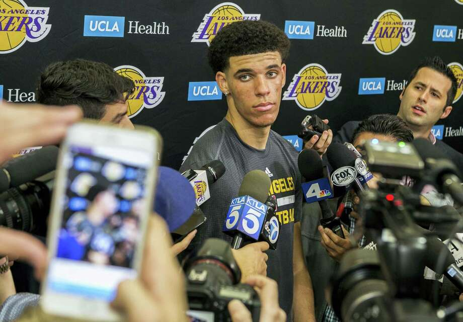 University of California Los Angeles guard Lonzo Ball takes questions from the media after a closed Los Angeles Lakes pre-draft workout in El Segundo, Calif. on Jun. 7, 2017. Photo: AP Photo — Damian Dovarganes  / Copyright 2017 The Associated Press. All rights reserved.