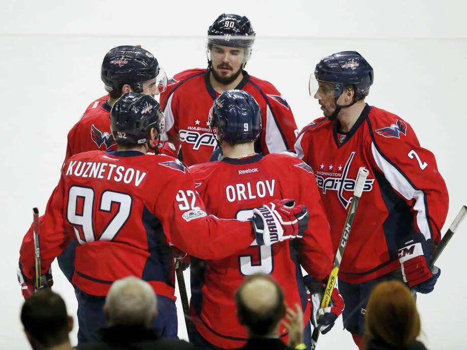 Washington Capitals center Evgeny Kuznetsov (92) of Russia is congratulated by his teammates Dmitry Orlov (9) also of Russia, Matt Niskanen (2), Marcus Johansson (90) of Sweden, and Tom Wilson (43) after scoring the fifth and final goal during the third period of an NHL hockey game in Washington, Wednesday, Feb. 1, 2017. The Capitals won 5-3. (AP Photo/Manuel Balce Ceneta) Photo: AP / Copyright 2017 The Associated Press. All rights reserved.