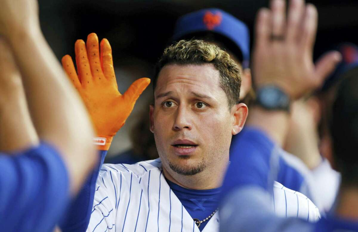 New York Mets' Asdrubal Cabrera celebrates with teammates after hitting a home run in the fourth inning of a baseball game against the Chicago Cubs, on Monday in New York.