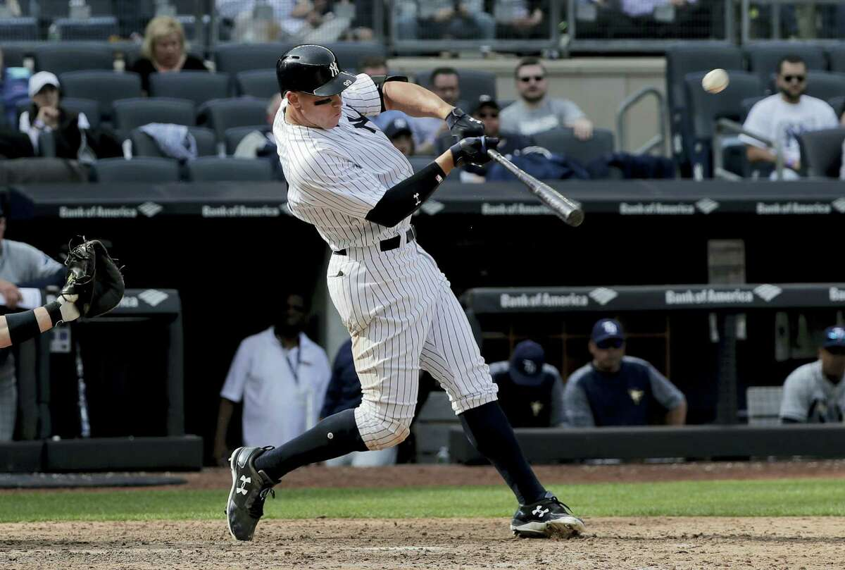 New York Yankees' Aaron Judge connects for a two-run home run against the Tampa Bay Rays during the seventh inning of a baseball game, Wednesday, April 12, 2017, in New York. (AP Photo/Julie Jacobson)