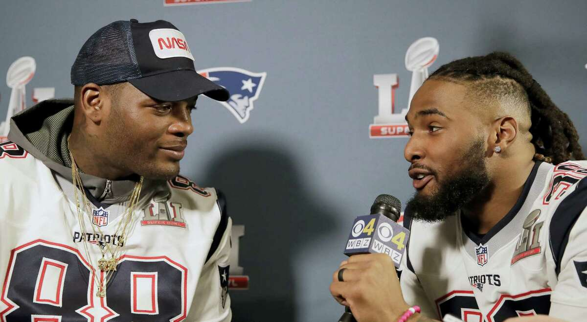 New England Patriots running back Brandon Bolden, right, interviews tight end Martellus Bennett during a media availability for the NFL Super Bowl 51 football game on Feb. 1, 2017 in Houston. The Patriots will face the Atlanta Falcons in the Super Bowl Sunday.