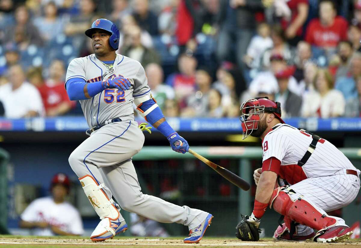New York'S Yoenis Cespedes watches his RBI double that scorde Michael Conforto, next to Philadelphia Phillies catcher Cameron Rupp during the first inning of the Mets' 5-4 victory.