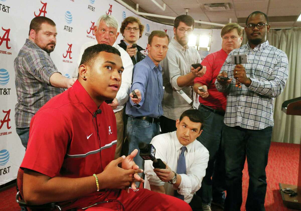 Highly touted quarterback recruit Tua Tagovailoa speaks to the media during a news conference announcing the recruiting class for the University of Alabama in Tuscaloosa, Ala. on Feb. 1, 2017. Tagovailoa is one of the players who took advantage of early enrollment.