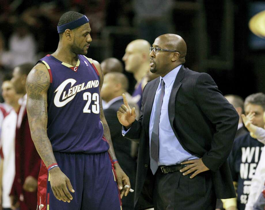 Cleveland Cavaliers coach Mike Brown talks strategy with LeBron James. Photo: Mark Duncan — The Associated Press File  / Copyright 2017 The Associated Press. All rights reserved.