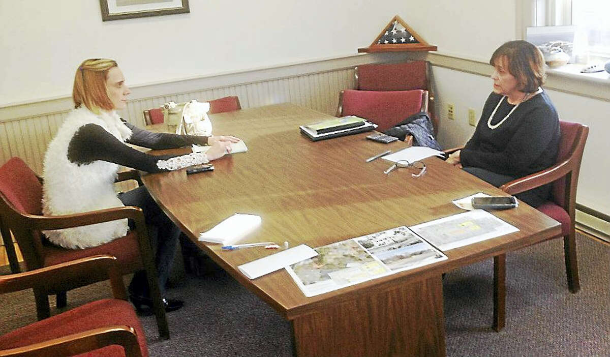Portland First Selectwoman Susan Bransfield, right, discusses details of the Elmcrest proposal with Rivereast reporter Elizabeth Regan in her office Wednesday.