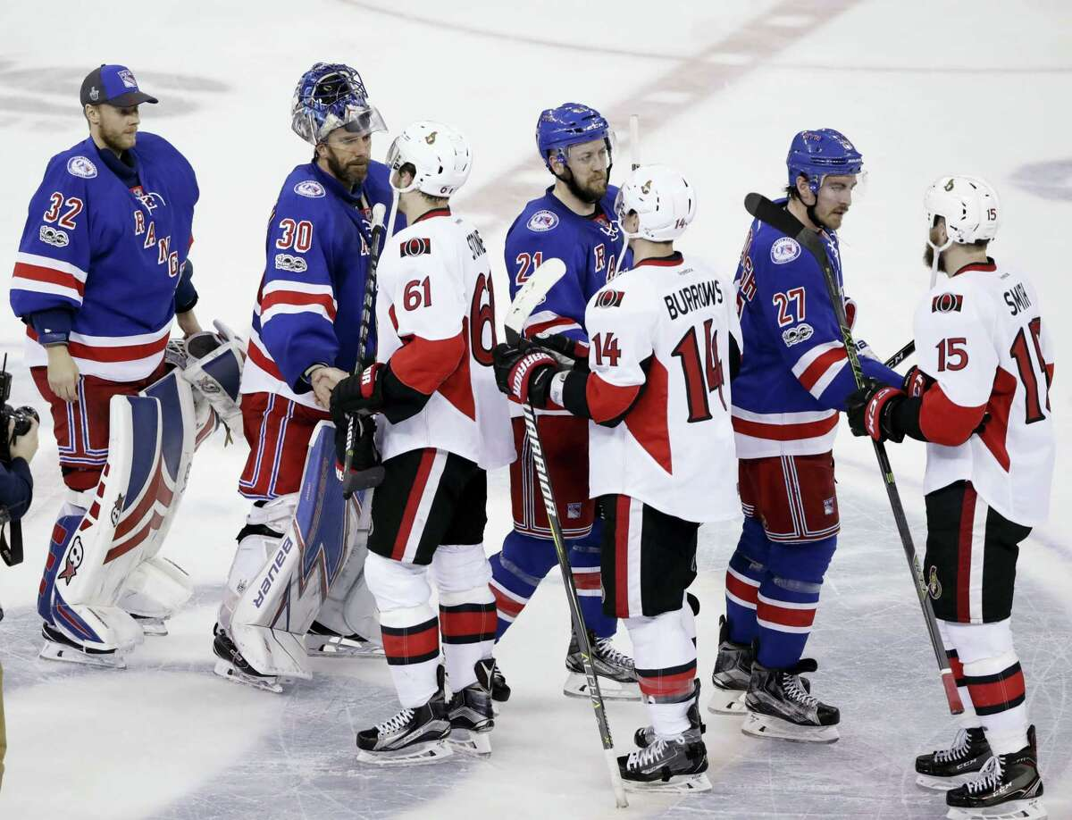 Members of the Rangers shake hands with members of the Senators after Game 6 of their playoff season..