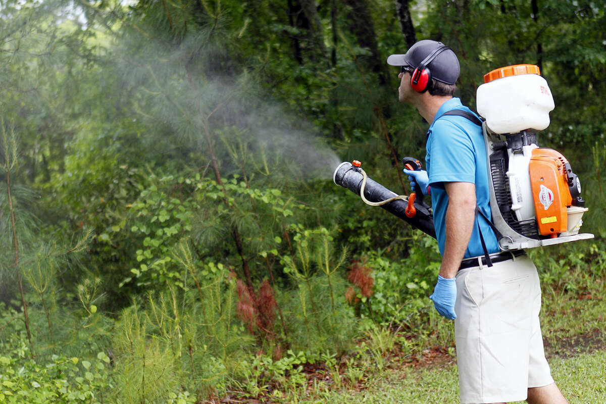 In this May 16, 2014 photo, Daniel Lewis, Mosquito Authority, sprays to kill mosquitos before the summer season, in Jacksonville, N.C. From landscaping to cleaning to pest control, businesses in maintenance industries that service residences and commercial buildings saw a 13 percent increase in sales in 2016, according to Sageworks. If you gain the right expertise, Sageworks analyst James Noe says, these businesses are easy to start because they have relatively low upfront costs and don't require large inventory, staff or dedicated office space.