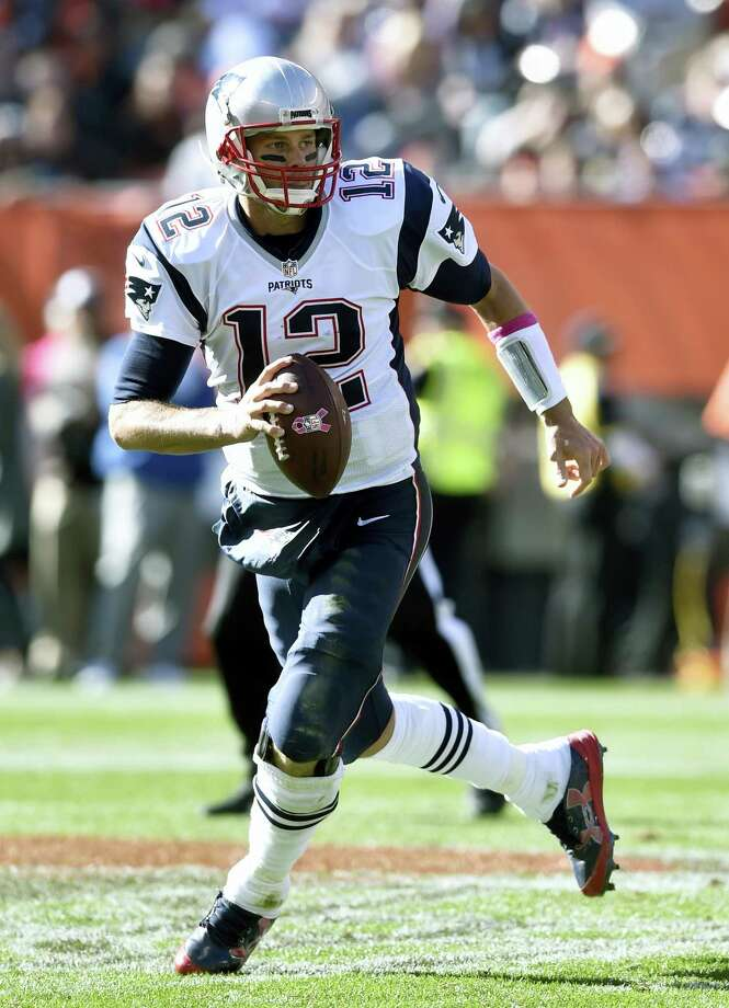 One of the prop bets for this year's Super Bowl asks who will score more points on Sunday — the Patriots offense led by Tom Brady or the Celtics' Isaiah Thomas. Photo: The Associated Press File Photo  / FR25496 AP