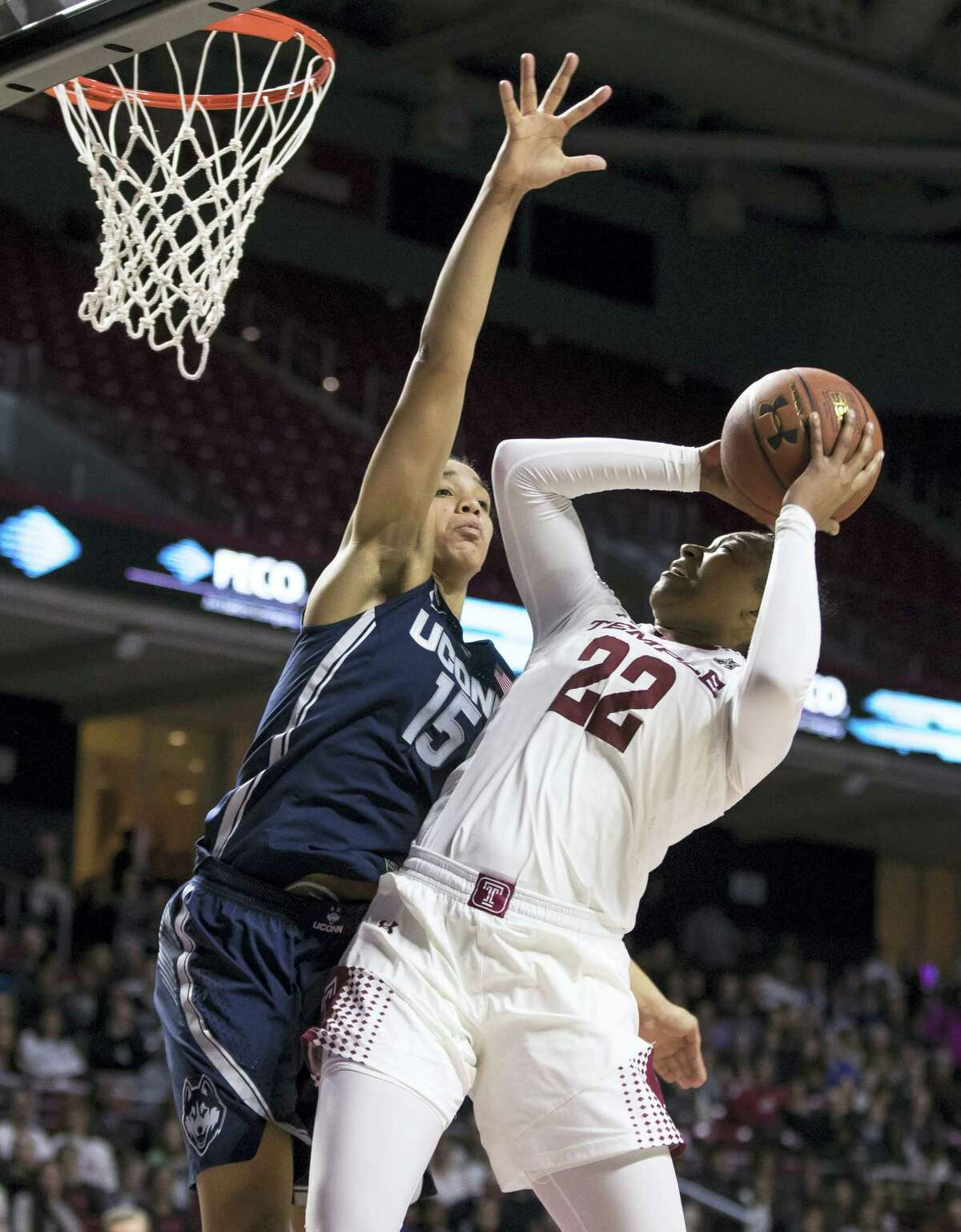 UConn's Gabby Williams, left, defends the basket against Temple's Tanaya Atkinson during Wednesday's game.