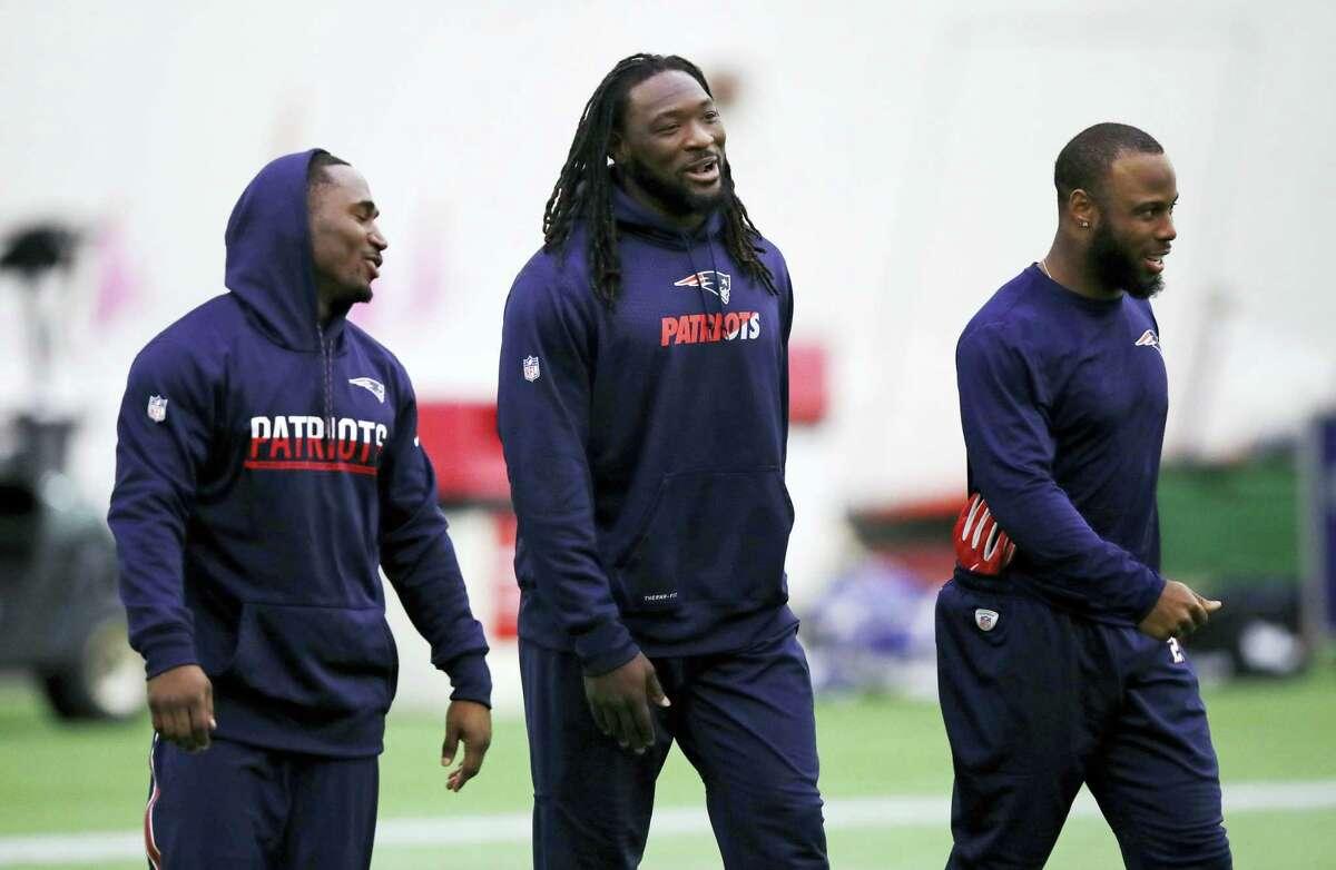 Patriots running backs LeGarrette Blount, center, Dion Lewis, left, and James White arrive for a recent practice.