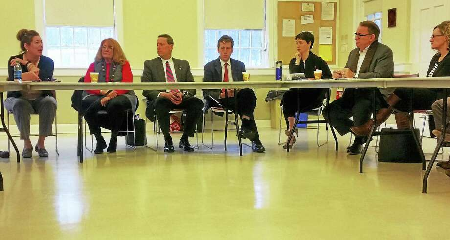 Members of the Middlesex County legislative delegation discuss the upcoming session Thursday at the deKoven House during a meeting of the Middlesex Coalition for Children in Middletown. Photo: Kathleen Schassler — The Middletown Press