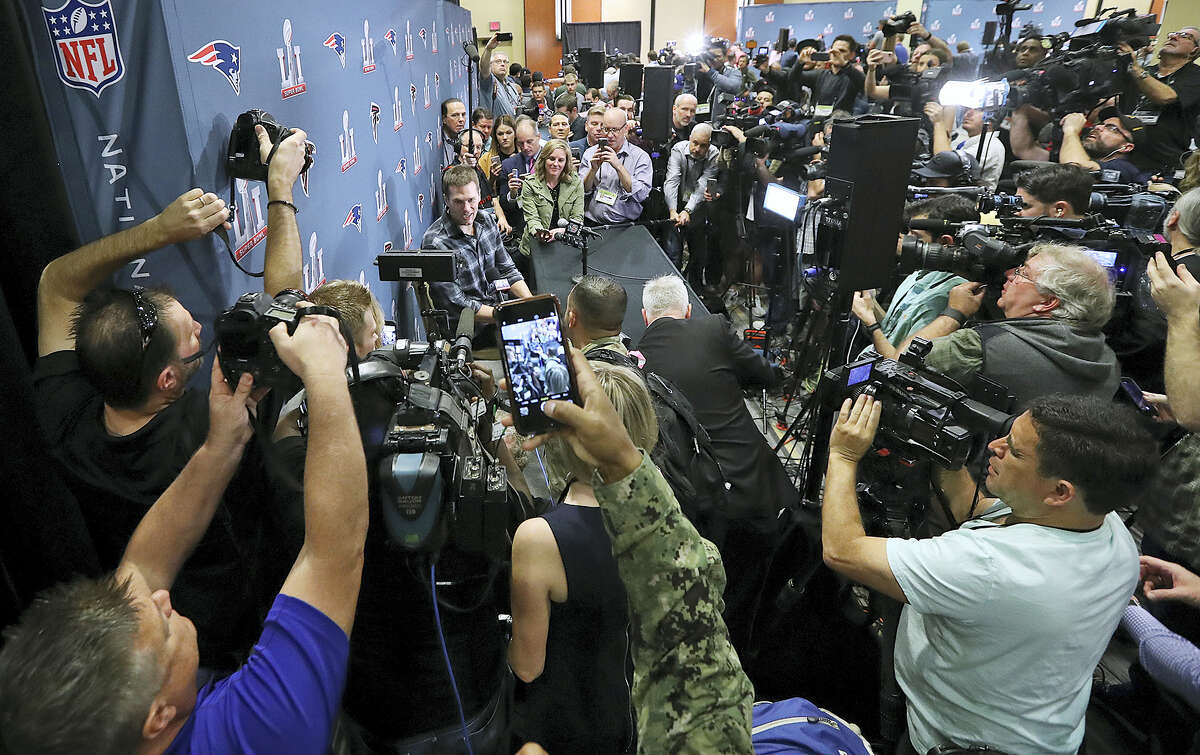 New England Patriots quarterback Tom Brady talks to the media during a news conference Tuesday in Houston.