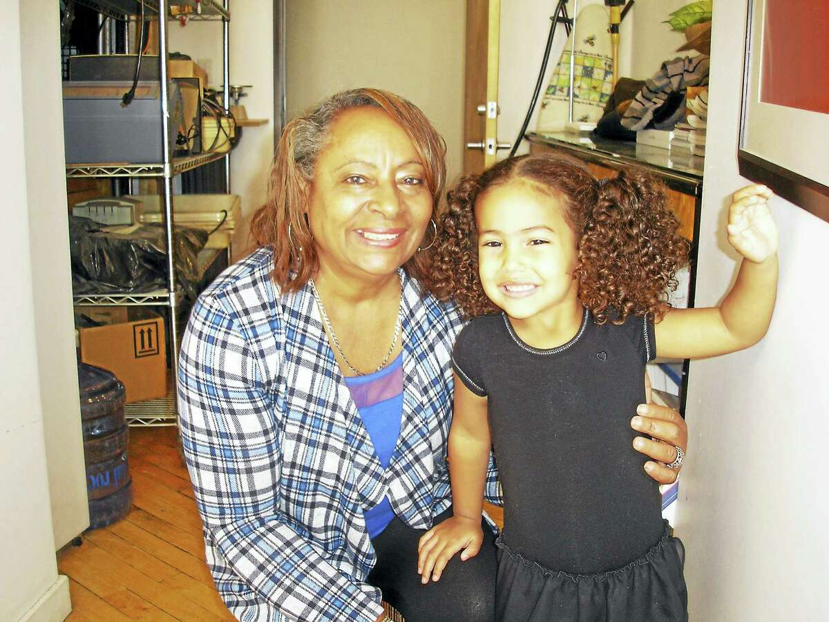 Nutmeg Big Brothers Big Sisters foster grandparent of the year, Middletown resident Carmen Sanchez, and Katrina, one of the children she mentors, enjoy each other's company at the Community Renewal Team's Locust Street Early Care and Education Center in Hartford.