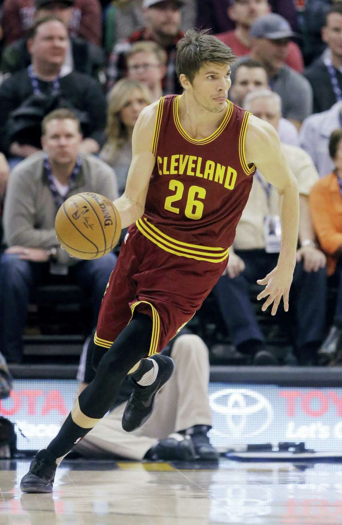Cleveland Cavaliers guard Kyle Korver (26) brings the ball up court in the first half during an NBA basketball game against the Utah Jazz on Jan. 10, 2017 in Salt Lake City.