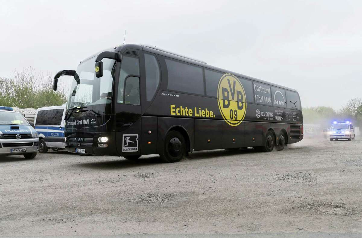 The team bus of Borussia is escorted by police as it takes an alternative route to the stadium prior to the Champions League first leg quarterfinal soccer match between Borussia Dortmund and AS Monaco in Dortmund, Germany, Wednesday, April 12, 2017.