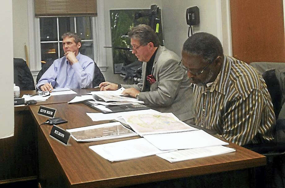East Hampton town councilors review the proposal to locate the Town Hall/police station complex on a 5.4-acre parcel within the Edgewater Hill development. Photo: Jeff Mill — The Middletown Press