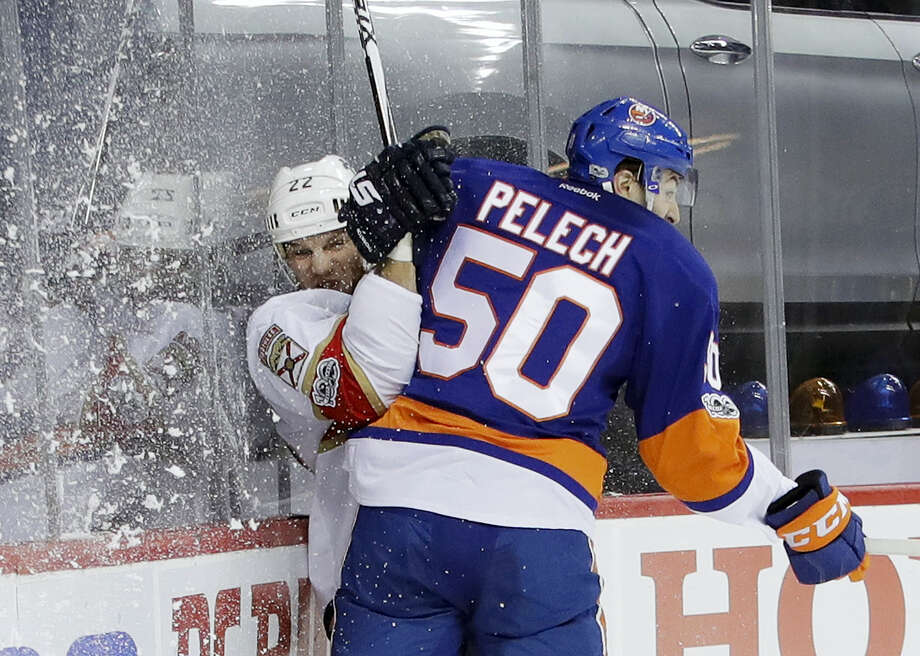 New York Islanders' Adam Pelech (50) checks Florida Panthers' Shawn Thornton (22) during the first period Wednesday in New York. Photo: Frank Franklin II — The Associated Press  / Copyright 2017 The Associated Press. All rights reserved.