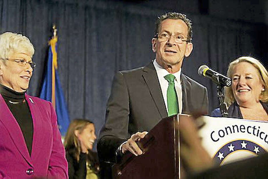 Gov. Dannel P. Malloy, center, Lt. Gov. Nancy Wyman, left, and Cathy Malloy on election night in 2014. Photo: CT News Junkie File Photo