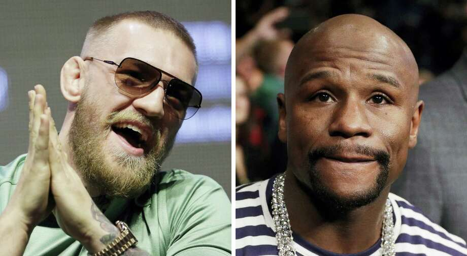 Conor McGregor, left, and Floyd Mayweather Jr. will face off on Aug. 26. Photo: The Associated Press File Photo  / AP
